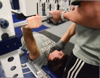 On Dec. 3, 2013, Feury required assistance from the athletic trainers with his weight lifting, as shown here with the bench press in the East Area Locker Rooms. It was Feury's first day lifting weights since he tore his ACL.